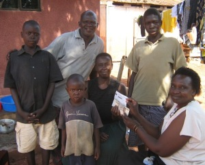 Mary's orphans sponsored by grassroors uganda displaying deed to their house