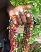 Image of colourful paper bead necklaces made by uganda women
