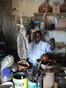 ssolongo, balibawo in his shop